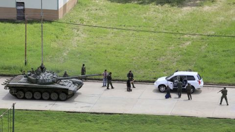 """Soldiers stop a vehicle and detain its passengers on the Paramacay military base in Valencia, Venezuela, on August 6. According to authorities, two people were killed when <a href=""""http://us.cnn.com/2017/08/06/americas/venezuela-unrest/index.html"""" target=""""_blank"""">an anti-government paramilitary attack was quelled</a> at the base."""