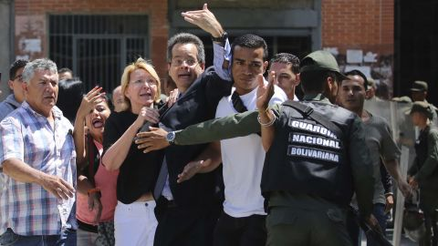 """Venezuela's Chief Prosecutor Luisa Ortega Diaz, third from left, is surrounded by employees of the General Prosecutor's office as she is <a href=""""http://edition.cnn.com/2017/08/05/americas/venezuela-attorney-general/index.html"""" target=""""_blank"""">barred by security forces from entering her office</a> in Caracas on Saturday, August 5."""