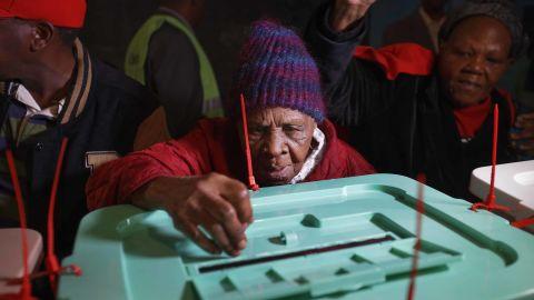 Lydia Gathoni, a Kenyatta supporter, voted just after dawn at a  station north of Nairobi.