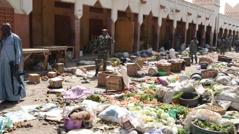 Soldiers stand guard at a market in N'Djamena following a suicide bomb attack on July 11, 2015. At least 14 people were killed in a suicide bomb attack at a crowded market in Chad's capital today just days after Boko Haram claimed a previous bombing in the city that left 38 people dead. The attack in N'Djamena by a man disguised as a woman in a full-face veil came after a botched bombing of a bus station in the restive capital of Nigeria's Borno state, Maiduguri, which killed two pedestrians.  AFP PHOTO / BRAHIM ADJI        (Photo credit should read BRAHIM ADJI/AFP/Getty Images)