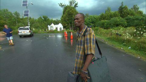 Jean-Enice Frederic prepares to illegally cross the U.S.-Canada border.