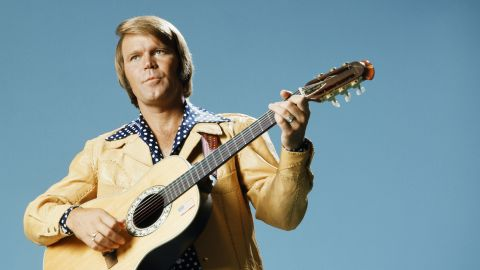 """<a href=""""http://www.cnn.com/2017/08/08/entertainment/glen-campbell-dies/index.html"""" target=""""_blank"""">Glen Campbell</a>, the upbeat guitarist from Delight, Arkansas, whose smooth vocals and down-home manner made him a mainstay of music and television for decades, died August 8 after a lengthy battle with Alzheimer's disease, his family announced on Facebook. The six-time Grammy Award winner was 81."""