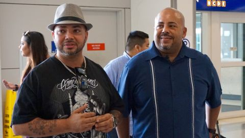 Brothers Anthony Wiggs and Raymond Abreu wait anxiously for their mother at Dallas Fort Worth International Airport.