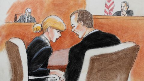 Taylor Swift, front left, conferred with her attorney in the civil trial on Tuesday.