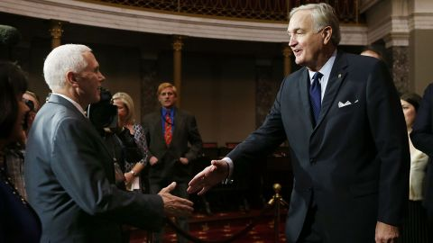 Vice President Mike Pence (L) shakes hands with Alabama's new Sen. Luther Strange (R-AL) before a mock swearing-in ceremony for Sen. Strange on February 9, 2017, in Washington.