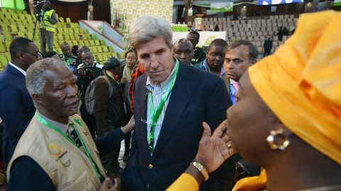"""Former US Secretary of State, John Kerry (C) talks with former South Africa president and African Union observer Thabo Mbeki (L) and an independent observer at the national tally centre on August 9, 2017 in Nairobi as final results for Kenya's presidential elections are anticipated. President Uhuru Kenyatta appeared headed for re-election Wednesday as his rival Raila Odinga rejected early results as """"fake"""", setting nerves on edge in east Africa's richest economy. With ballots from 90 percent of polling stations counted, electoral commission (IEBC) results showed Kenyatta leading with 54.6 percent of the nearly 13 million ballots tallied against Odinga's 44.5 percent, a difference of 1.3 million votes.  / AFP PHOTO / TONY KARUMBA        (Photo credit should read TONY KARUMBA/AFP/Getty Images)"""