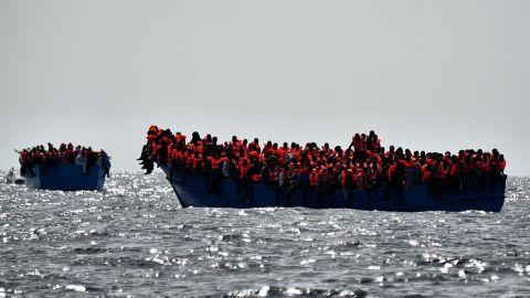 A file photo shows migrants waiting to be rescued as they drift in the Mediterranean Sea off the coast of Libya on October 3, 2016.