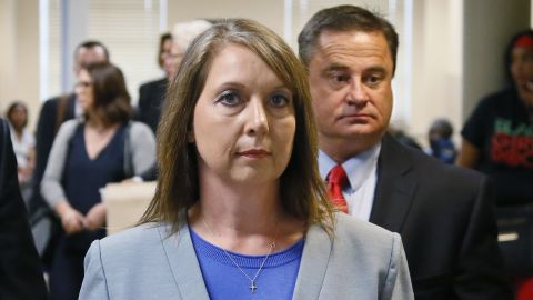 Betty Shelby leaves the courtroom with her husband, Dave Shelby, during her trial in May.