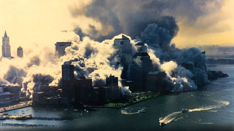 New York Waterway ferries and thrill ride/tour boat Chelsea Screamer (far right) evacuated passengers as the second tower collapsed. The white tent covering the World Financial Center ferry terminal can be seen at the edge of the advancing dust cloud.