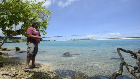 Marco Martinez, 27, fishing in Hagatna. He'll likely be the character i lead the story with