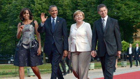 Merkel and her husband, Joachim Sauer, walk with US President Barack Obama and first lady Michelle Obama before a dinner in Berlin in June 2013. Merkel and Sauer have been married since 1998.