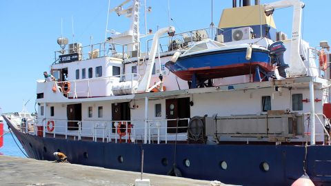 """A picture taken on July 27, 2017 shows the C-Star vessel, hired by far-right activists from a group which calls itself """"Generation Identity"""" to prevent would-be migrants from reaching Europem, anchored in the Mediterranean port of Famagusta in the self-proclaimed Turkish Republic of Northern Cyprus (TRNC). Turkish Cypriot authorities have released the captain and crew of the ship, local media reported and the C-Star was expected to set off across the Mediterranean to Tunisia, said Kibris Postasi.  The """"Defend Europe"""" scheme was announced by anti-immigration campaigners from France, Italy and Germany after they crowd-funded the 76,000 euros ($87,000) needed to hire the vessel. / AFP PHOTO / STRINGER        (Photo credit should read STRINGER/AFP/Getty Images)"""