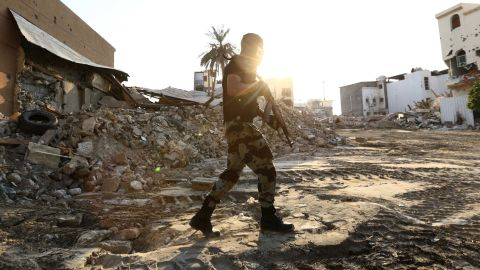 A member of Saudi Special Forces holds his weapon as he walks in the town of Awamiya.