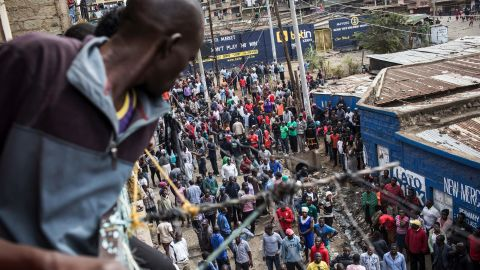 People gather around the house of Steve George, a young boy allegedly killed by gunfire as he stood on the balcony of his house in the Mathare slum in Nairobi.