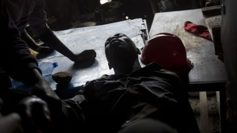An Odinga supporter is treated after being shot during protests in the Kibera slum of Nairobi.