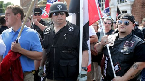 """Hundreds of white nationalists, neo-Nazis and members of the """"alt-right"""" march down East Market Street toward Lee Park during the """"United the Right"""" rally August 12, in Charlottesville, Virginia. After clashes with anti-facist protesters and police the rally was declared an unlawful gathering and people were forced out of Lee Park, where a statue of Confederate General Robert E. Lee is slated to be removed."""