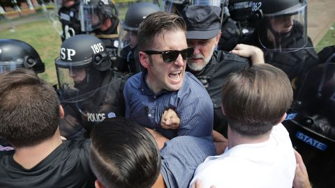 """White nationalist Richard Spencer and his supporters clash with Virginia State Police in Lee Park after the """"Unite the Right"""" rally was declared an unlawful gathering August 12, 2017 in Charlottesville, Virginia. Hundreds of white nationalists, neo-Nazis and members of the """"alt-right"""" clashed with anti-facist protesters and police as they attempted to hold a rally in Lee Park, where a statue of Confederate General Robert E. Lee is slated to be removed."""