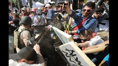 White nationalists, neo-Nazis and members of the alt-right movement exchange volleys of pepper spray with counterprotesters as they enter Emancipation Park.
