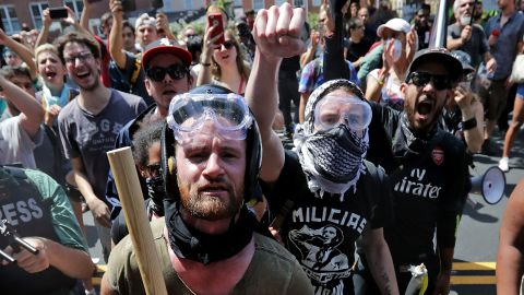 """Anti-fascist counter-protesters wait outside Lee Park to hurl insluts as white nationalists, neo-Nazis and members of the """"alt-right"""" are forced out after the """"Unite the Right"""" rally was declared an unlawful gathering August 12, 2017 in Charlottesville, Virginia. After clashes with anti-fascist protesters and police the rally was declared an unlawful gathering and people were forced out of Lee Park, where a statue of Confederate General Robert E. Lee is slated to be removed."""