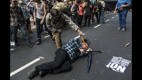 A counterprotester strikes a white nationalist with a baton during clashes at Emancipation Park, where white nationalists are protesting the removal of the Confederate Gen. Robert E. Lee monument.