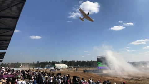 A plane flies over the grounds of the 2017 Russia Army Games in Alabino, Moscow on August 12.