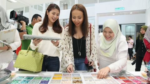 At the launch event, at the The Empire Hotel and Resort in Brunei, hundreds of women bought the limited-edition scarf collection, which retailed for $140 per piece.