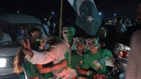Youths wear masks as they march on a street in Islamabad on the night of August 13, 2017, to mark the country's Independence Day.