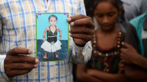 Mohammad Zahid, who lost his five-and-a-half year old daughter Khushi, holds his daughter's photograph in Gorakhpur in the Indian state of Uttar Pradesh, on August 14.