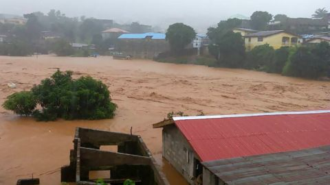 Floodwaters overwhelm the streets of Regent in Freetown on Monday.