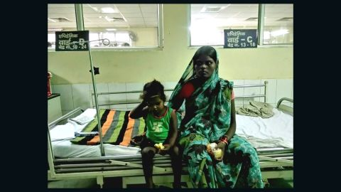 Prince, 3, waits with his mother at Baba Raghav Das (BRD) Medical College. His grandmother is trying to get him discharged from the hospital after the deaths of dozens of children.