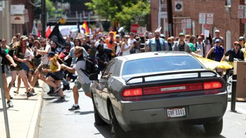 Demonstrators bolted out of the way of a car just before it struck the group of counterprotesters.