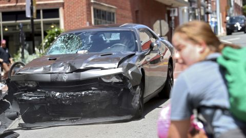 The damaged car sped away in reverse after striking the demonstrators.
