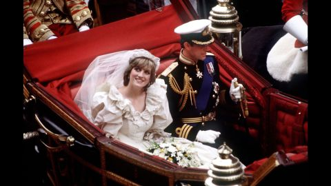 The Prince and Princess of Wales return to Buckingham Palace by carriage after their wedding, July 29, 1981. She wears a wedding dress by David and Elizabeth Emmanuel and the Spencer family tiara.