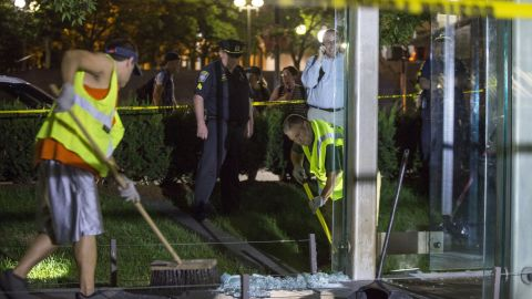 BOSTON, MA - AUGUST 14:  Workers clean up broken glass at the New England Holocaust Memorial that was vandalized when a rock was thrown through a panel that was part of it on August 14, 2017 in Boston, Massachusetts.  (Photo by Scott Eisen/Getty Images)