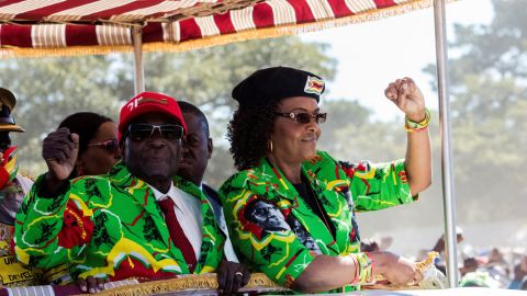 Robert and Grace Mugabe raise their fists before meeting delegates in Marondera in June.