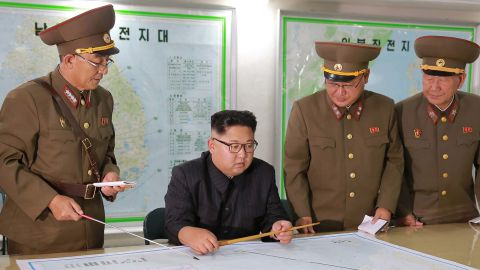 """TOPSHOT - This picture taken on August 14, 2017 and released from North Korea's official Korean Central News Agency (KCNA) on August 15, 2017 shows North Korean leader Kim Jong-Un (C) inspecting the Command of the Strategic Force of the Korean People's Army (KPA) at an undisclosed location. North Korean leader Kim Jong-Un said on August 15 he would hold off on a planned missile strike near Guam, but warned the highly provocative move would go ahead in the event of further """"reckless actions"""" by Washington. / AFP PHOTO / KCNA VIA KNS / STR / South Korea OUT / REPUBLIC OF KOREA OUT   ---EDITORS NOTE--- RESTRICTED TO EDITORIAL USE - MANDATORY CREDIT """"AFP PHOTO/KCNA VIA KNS"""" - NO MARKETING NO ADVERTISING CAMPAIGNS - DISTRIBUTED AS A SERVICE TO CLIENTS THIS PICTURE WAS MADE AVAILABLE BY A THIRD PARTY. AFP CAN NOT INDEPENDENTLY VERIFY THE AUTHENTICITY, LOCATION, DATE AND CONTENT OF THIS IMAGE. THIS PHOTO IS DISTRIBUTED EXACTLY AS RECEIVED BY AFP.  /         (Photo credit should read STR/AFP/Getty Images)"""