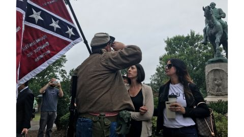 Allen Armentrout salutes a statue of Confederate Gen. Robert E. Lee in Charlottesville, Virginia, on Tuesday. Armentrout was confronted by residents.