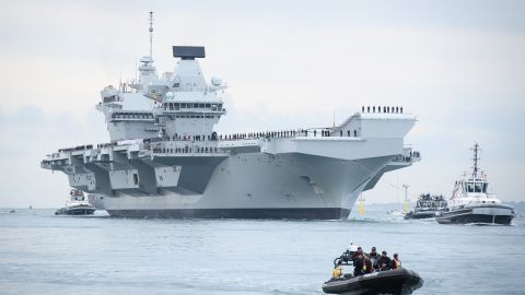 PORTSMOUTH, ENGLAND - AUGUST 16:  The HMS Queen Elizabeth supercarrier heads into port on August 16, 2017 in Portsmouth, England.  The HMS Queen Elizabeth is the lead ship in the new Queen Elizabeth class of supercarriers. Weighing in at 65,000 tonnes she is the largest war ship deployed by the British Royal Navy.   (Photo by Leon Neal/Getty Images)