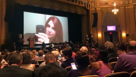 Photos of Heather Heyer are shown as people take their seats at a memorial service for Heyer at the Paramount Theater, in Charlottesville, Virginia, on August  16, 2017.