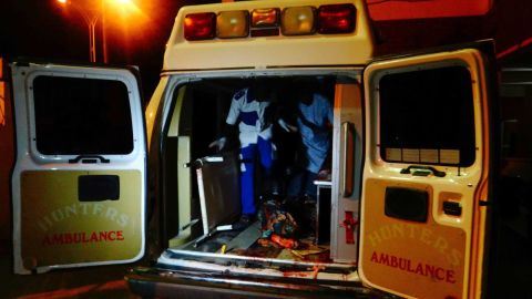 An injured victim of a female suicide bomber arrives in an ambulance for medical attention at a Maiduguri hospital.