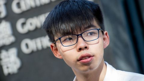 Student protest leader Joshua Wong speaks to the media about his recent arrest and detention ahead of the visit by China's President Xi Jinping, outside Civic Square at the Central Government Offices in Hong Kong on June 30, 2017.
