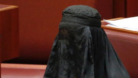 Senator Pauline Hanson wears a burqa in the Senate chamber at Parliament House in Canberra, Australia, Thursday, Aug. 17.