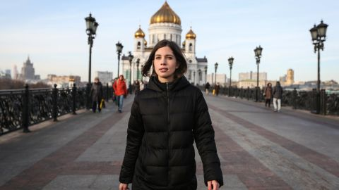 Tolokonnikova walks to her first public news conference following her release from prison with the Christ the Saviour Cathedral in the background.