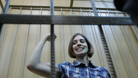 Pussy Riot's Nadya Tolokonnikova is seen behind the bars during a trial in Moscow.