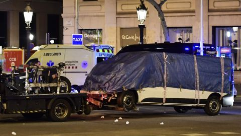 The van that plowed into the crowd in Barcelona is towed away from Las Ramblas on August 18.