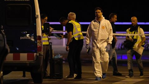 Police officers work at the scene in Cambrils.
