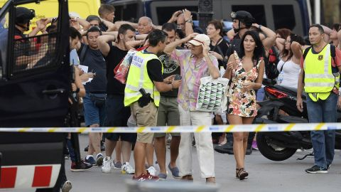 Police check people's identities as they clear Las Ramblas on August 17.