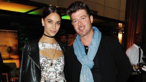 April Love Geary and Robin Thicke in 2016.