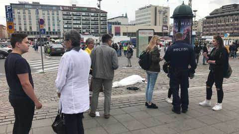 A body covered in a white sheet was photographed at the attack site.