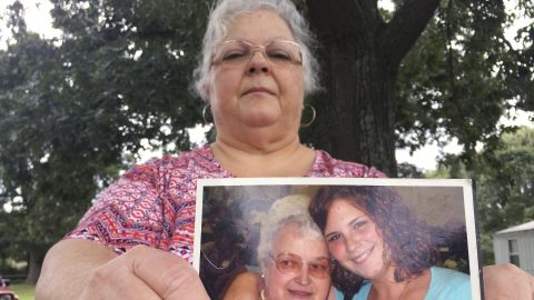 Susan Bro, the mother of Heather Heyer, holds a photo of Bro's mother and her daughter, Monday, Aug. 14, 2017, in Charlottesville, Va. Heyer was killed Saturday, Aug. 12, 2017, when police say a man plowed his car into a group of demonstrators protesting the white nationalist rally. Bro said that she is going to bare her soul to fight for the cause that her daughter died for.